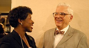 Gwen Ifill laughing with mentor and professor Alden Poole