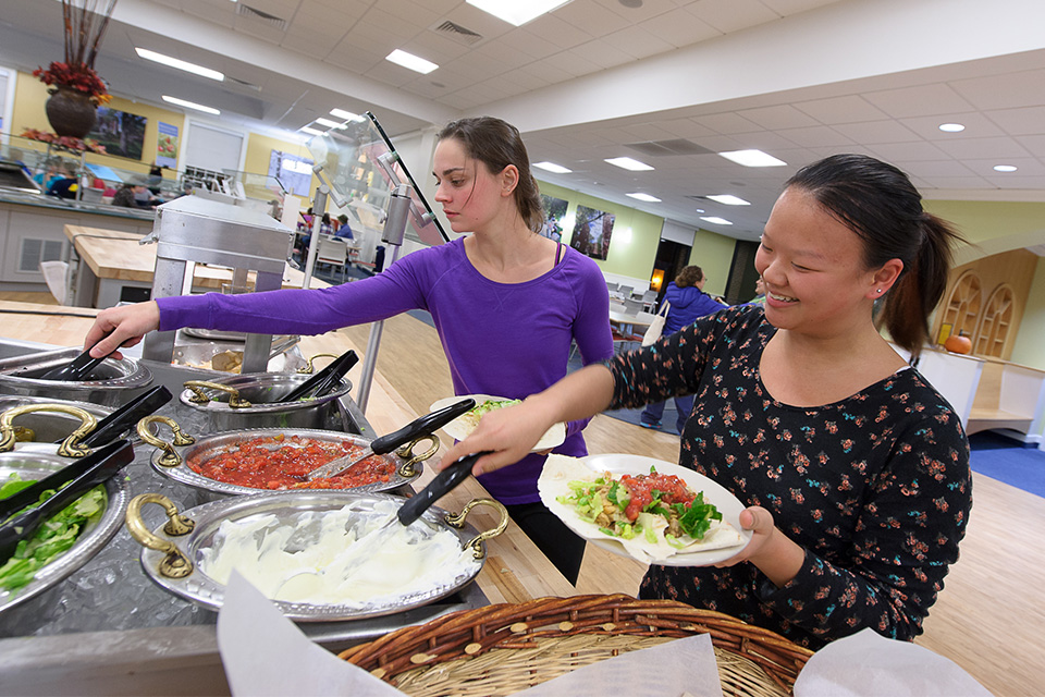 Students eating in dining hall.