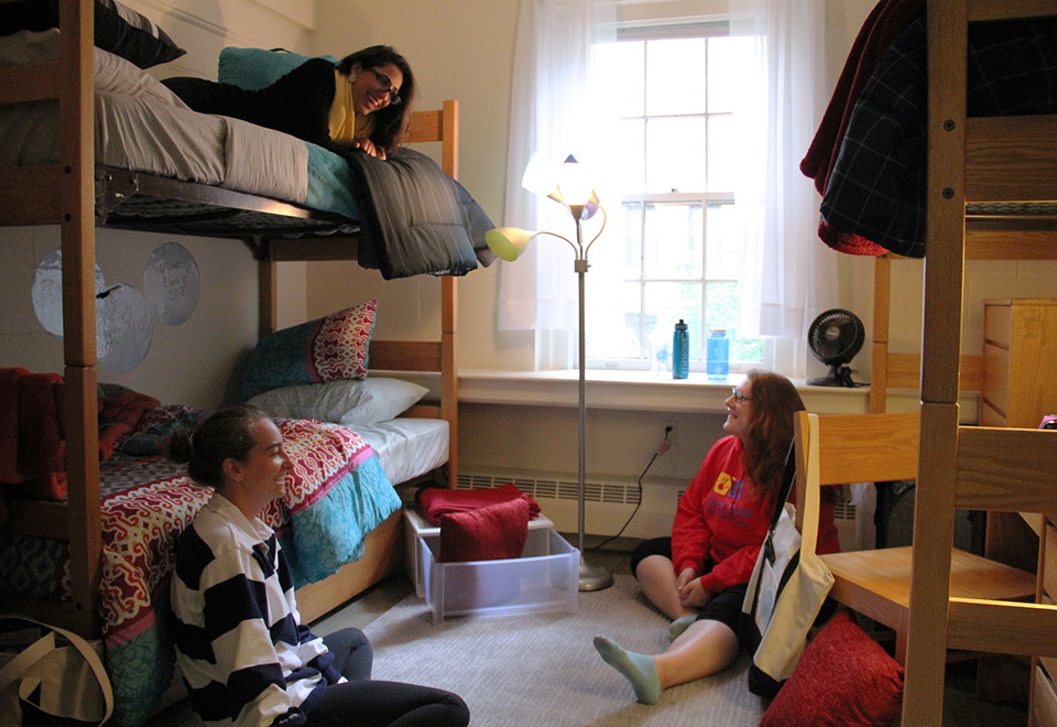 Students sitting in a dorm room