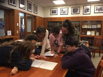 Students studying together in the archives.