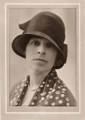 Headshot of Eva Whiting White