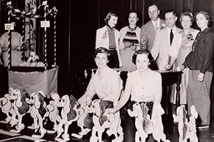 Students and faculty standing with toy poodles