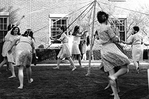 May Day - Students Dancing Around the Pole in the Same Dress