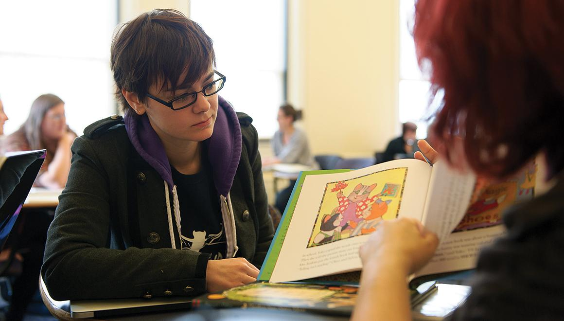 Student looking at a picture book
