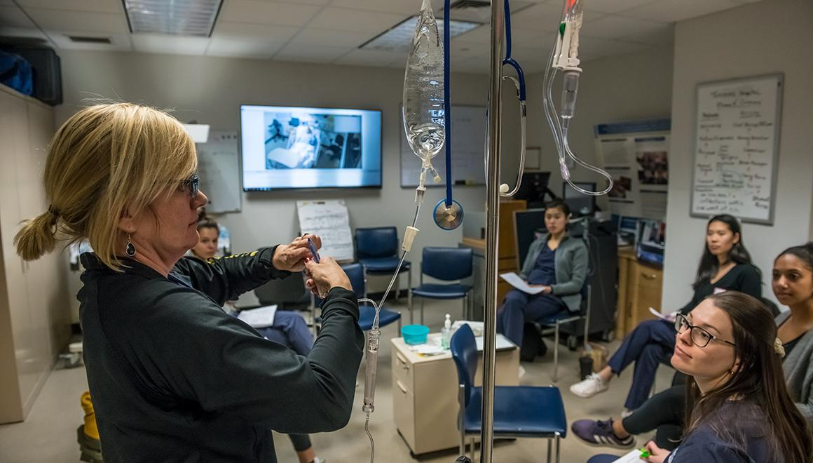 Students in a nursing simulation lab