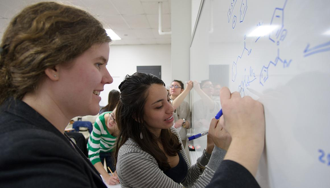 Students working on a white board