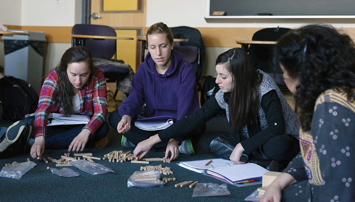 Students sitting together in class working on a project