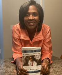 "Lynn Perry Wooten holding ""What the Eyes Don't See"" by Dr. Mona Hanna-Attisha"