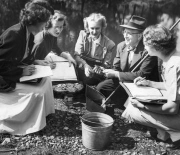 Archive photo of faculty and students doing outdoor field work in the 1940s