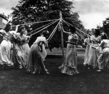 Archive photo of students dancing around the May pole on May Day 1950