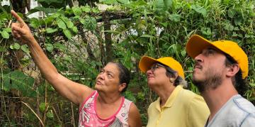 Carmen Báez and Andre de Haro (PRxPR) inspecting damage housing with resident of Villa Calma community  in Toa Baja, PR - July 2019