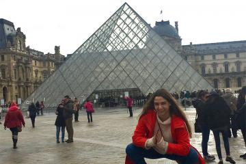 Kaitlyn Lapeyre in front of the Louvre.