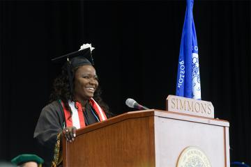 Tozoe Marton speaking at commencement.