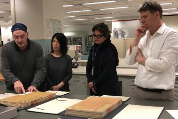 Conservators Alan Haley, Qui Qi, Ann Roddy, and Dan Patterson in the conservation department of the Library of Congress, working with the Yongle Da Dian.
