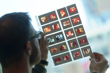 Librarian reviewing film negatives