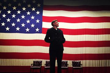 Vin Sowders standing in front of a U.S. Flag