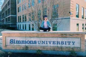 Lilli Thorne on the Simmons University sign