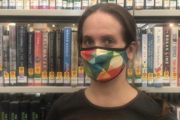 Kate Leppanen wearing a mask in the library