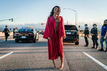 Jada Riley in her graduation gown attending a protest against police brutality.