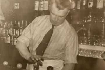 "Assistant Professor Eric Poulin's great-grandfather Lester ""Buster"" Brown, bartending at Luchessi's Cafe in the 1940s."