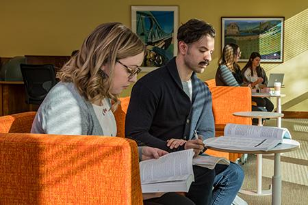 Students studying in the library's quiet study room.