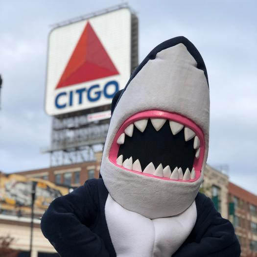 Stormy the Shark in front of the CITGO sign