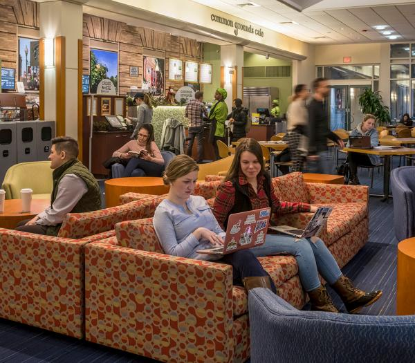Students sitting in a common area in the Main College Building at Simmons University