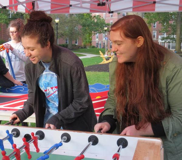 Students playing a game on the residential quad