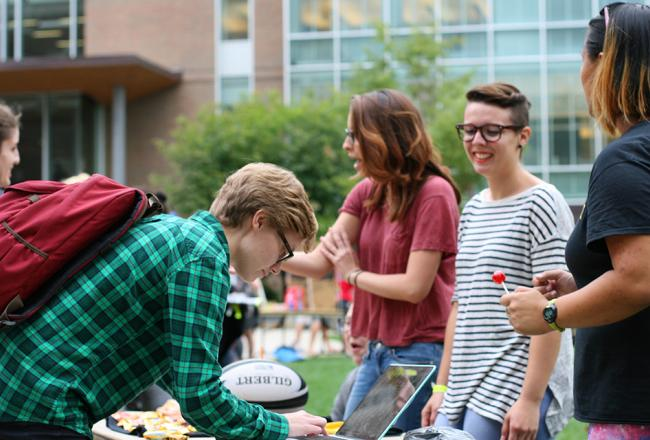 Students signing up for activities on the residential quad