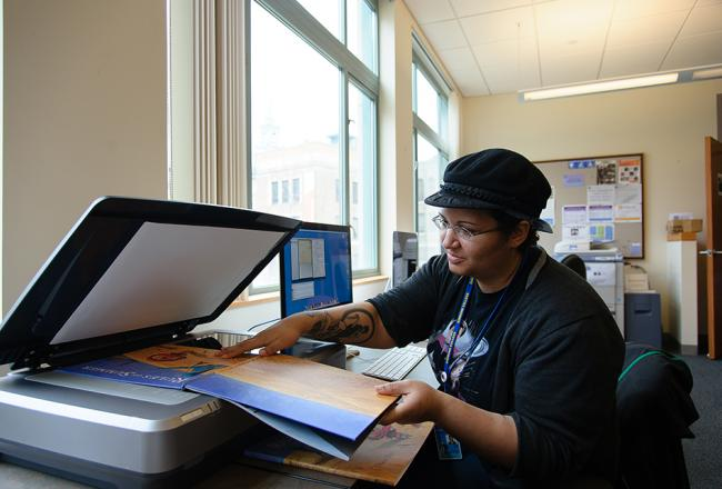 Student copying a book in a copying machine