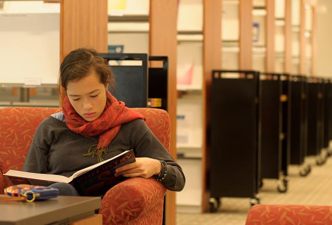 Student sitting in the library