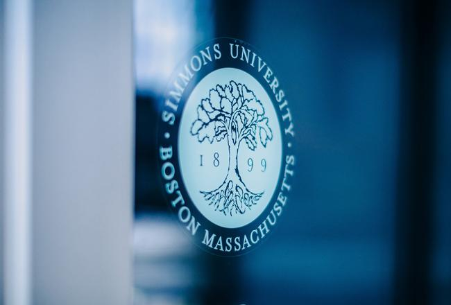 Simmons University logo on a wall