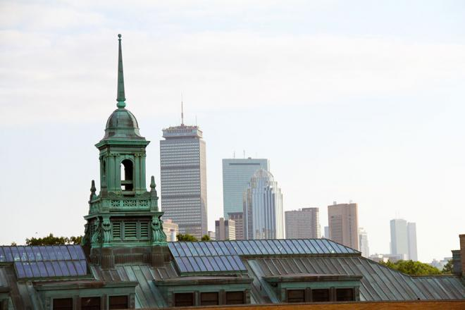Simmons University Main College Building's cupola with the Boston city skyline in the background