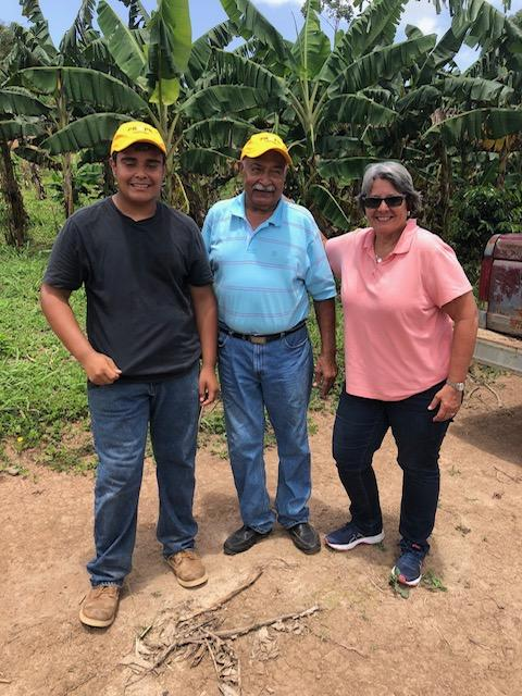 Jose Esteban López Maldonado - the youngest certified farmer in Puerto Rico and founder of the Esteban Bianchi Maldonado Agricultural School and PRxPR grantee + his father + Carmen Baez in Adjuntas, PR. July 2019
