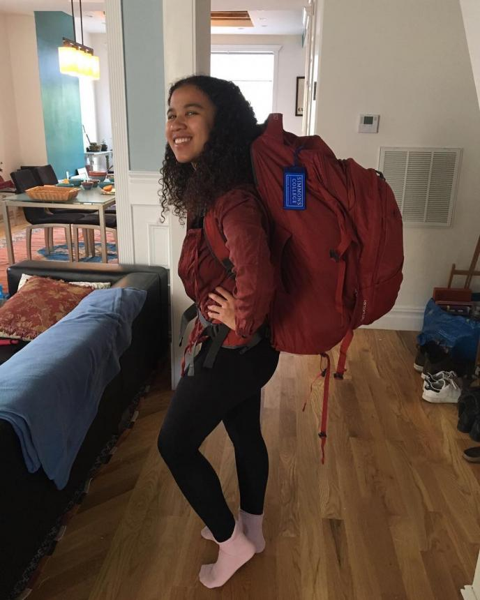 Kelsey wearing a very large backpack in preparation for her trip to Bali.
