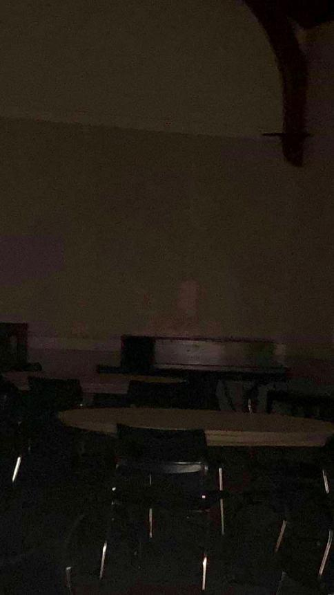 A possible apparition sitting at a table in the Linda K. Paresky Conference Center.