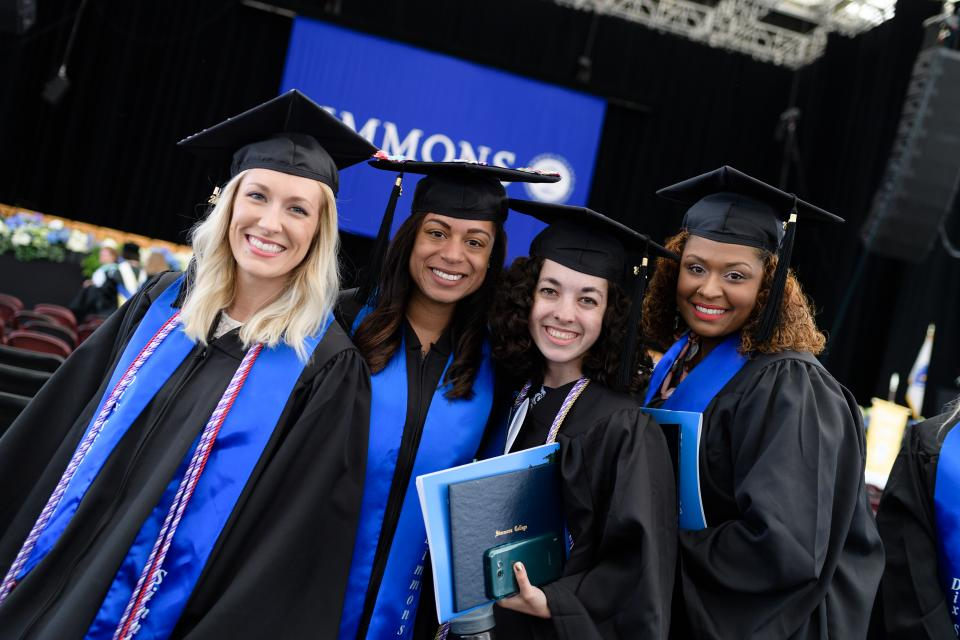 Dix scholars celebrating after the commencement ceremony.