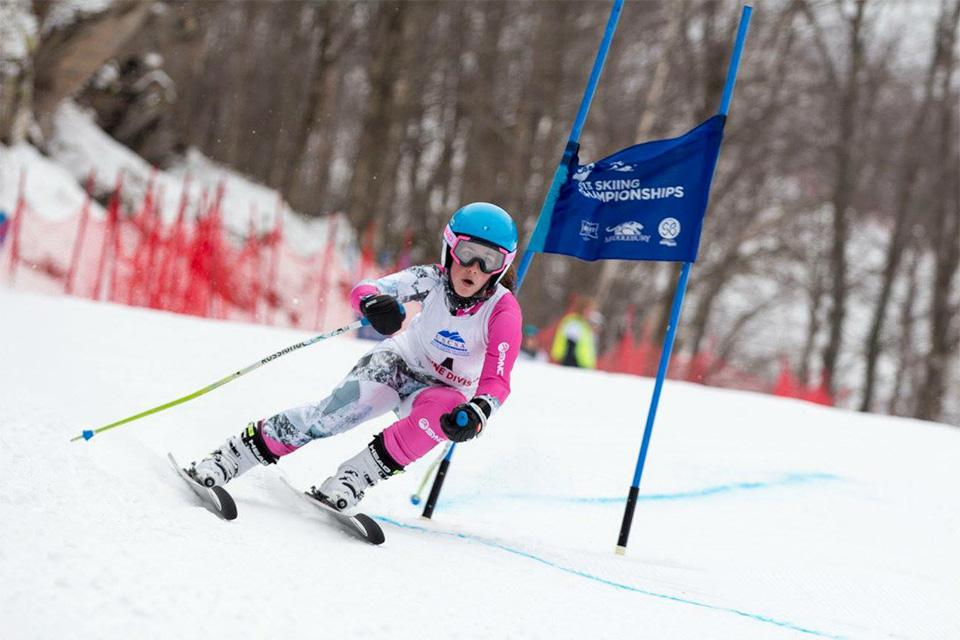 Lindsey Sumpman in downhill skiing competition.