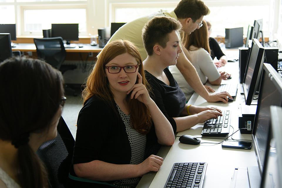 Students studying in a computer lab.
