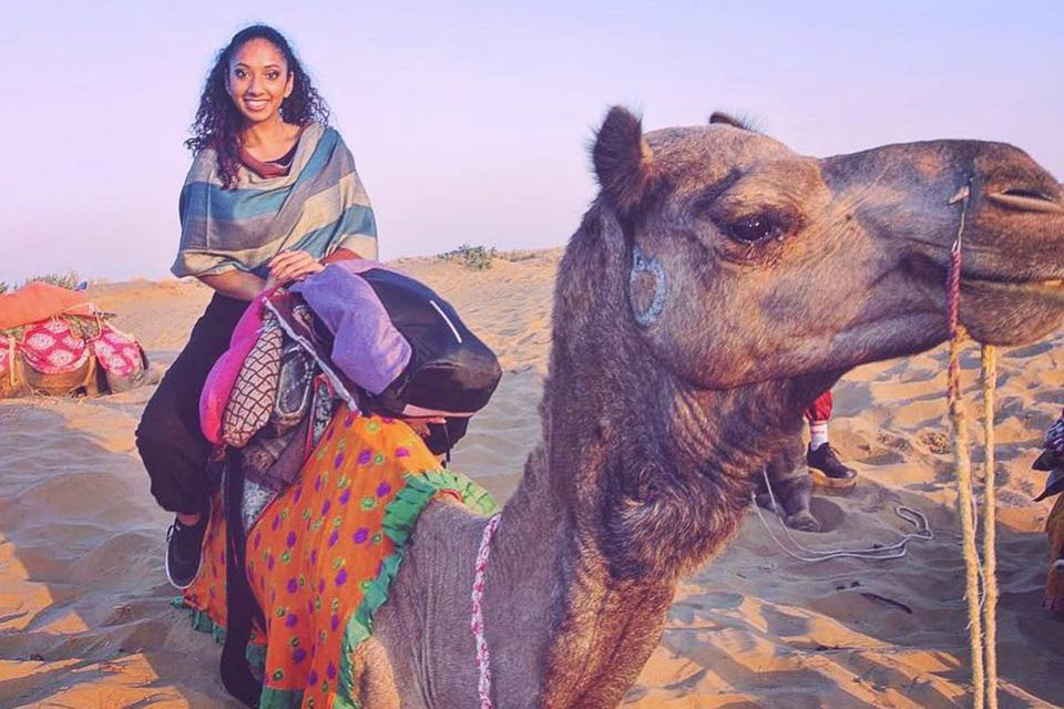 Samantha Sochan riding a camel.