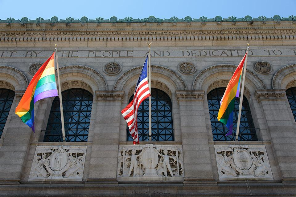 Pride flags and U.S.flag outside of Boston Public Library.