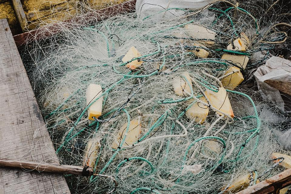 Tangle of fishing nets in a boat.