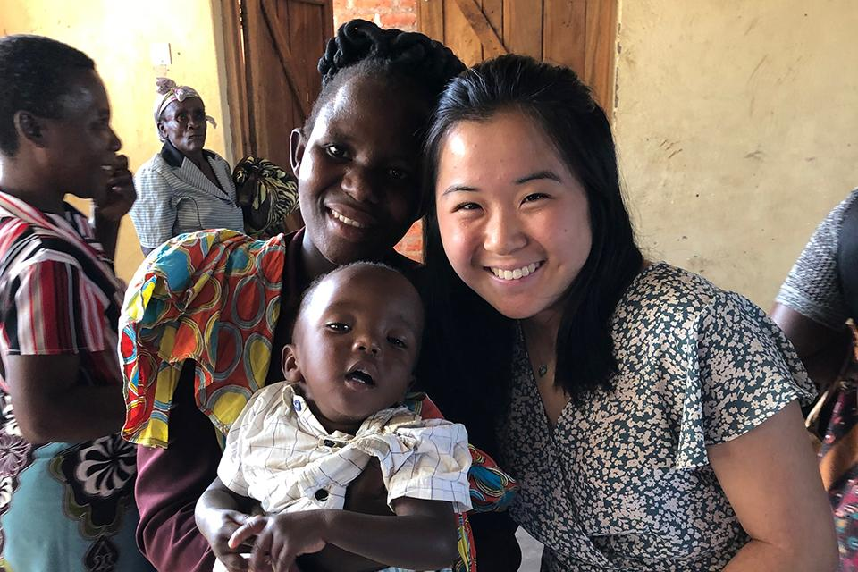 Donata Liu with a Malawian woman and her child.